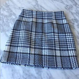 Tweed mini skirt with gold zipper detail
